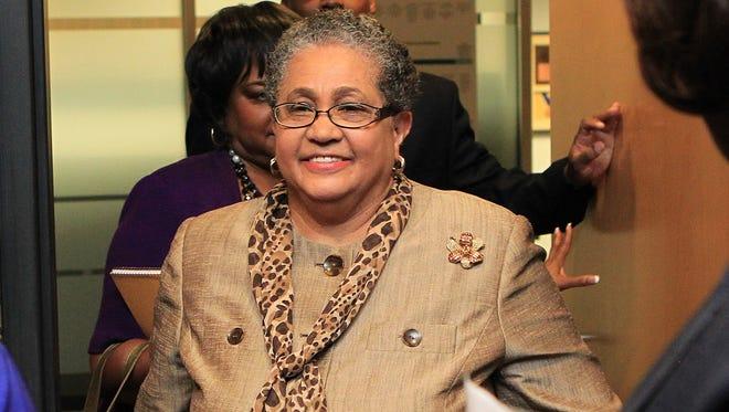 The former Atlanta schools superintendent, Beverly Hall, arrives for her last Atlanta School Board meeting in 2011.