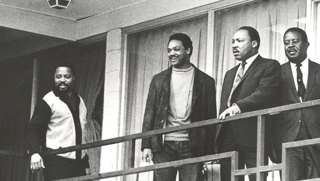 Martin Luther King Jr., second right, and SCLC aides Hosea Williams, Jesse Jackson Jr., from left, and Ralph Abernathy return to the Lorraine Motel in Memphis to strategize for the second Sanitation Workers march led by King on April 3, 1968.