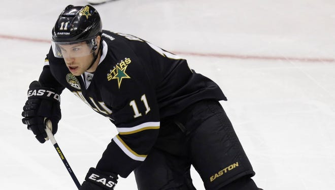 Dallas Stars center Derek Roy is heading to the Vancouver Canucks for a prospect and a second-round pick.