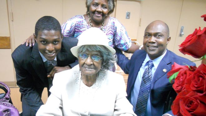 Godson Tyler Kinloch, daughter Thelma, friend Michael Kinloch and Jeralean Talley at her 113th birthday celebration May 1, 2012.