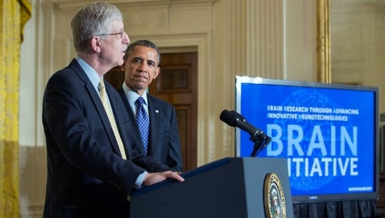 President Obama is introduced by Francis Collins, director of the National Institutes of Health, at the BRAIN Initiative event Tuesday in the White House.