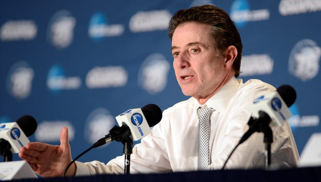 Louisville Cardinals head coach Rick Pitino speaks at a press conference after the Midwest regional of the 2013 NCAA tournament against the Duke Blue Devils.