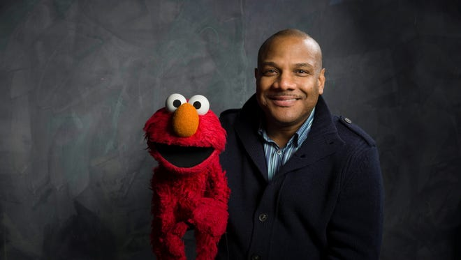 This Jan. 24, 2011 file photo shows Elmo and puppeteer Kevin Clash.