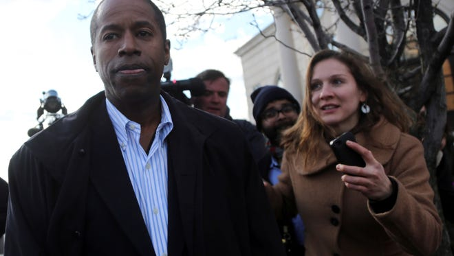 Sen. Malcolm Smith, D-Queens, leaves federal court, Tuesday, April 2, 2013 in White Plains, N.Y.  The Democratic state lawmaker was arrested along with five other politicians Tuesday in an alleged plot to pay tens of thousands of dollars in bribes to GOP bosses to let him run for mayor of New York City as a Republican.