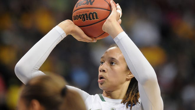 Baylor's Brittney Griner (42) attempts a shot in the second half against the Louisville Cardinals during the semifinals of the Oklahoma City regional of the 2013 NCAA  tournament at Chesapeake Energy Arena.