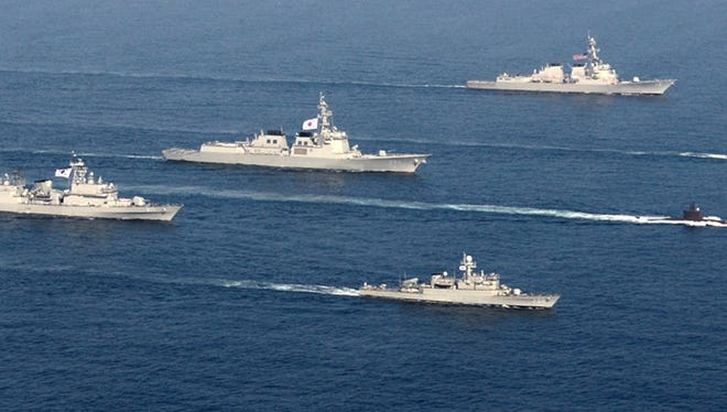 South Korea and U.S. warships participate in a joint military drill in South Korea's East Sea on March 19.