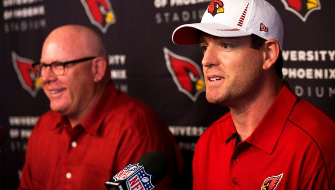 New Cardinals QB Carson Palmer answers questions Tuesday while coach Bruce Arians, left, beamed.
