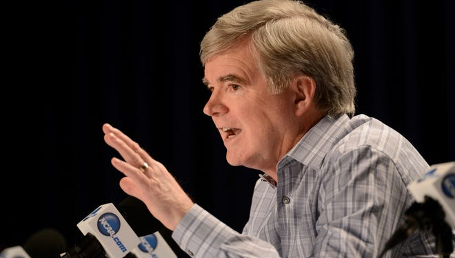 NCAA President Mark Emmert addresses the news media during a 41-minute press conference.