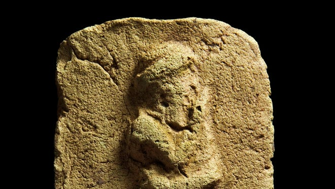 A clay plaque found during a British excavation in Iraq shows a worshipper approaching a sacred place.