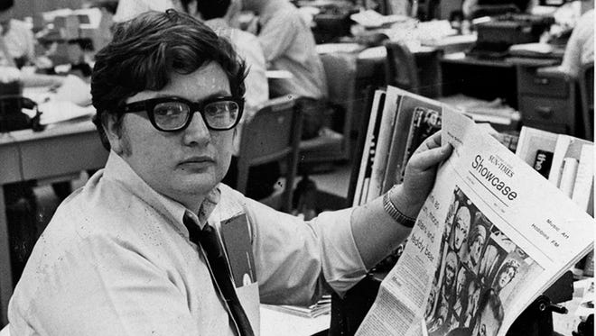 This 1969 photo shows 'Chicago Sun-Times' movie critic Roger Ebert in the newsroom of the paper in Chicago. Ebert, the most famous and popular film reviewer of his time who became the first journalist to win a Pulitzer Prize for movie criticism and, on his long-running TV program, wielded the nation's most influential thumb, died April 4.