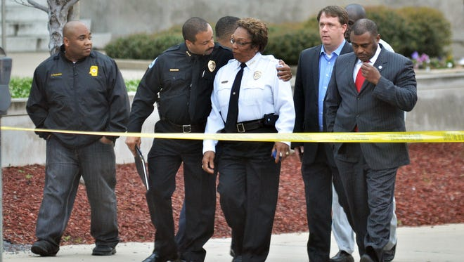 Jackson, Miss., Assistant Chief Lee Vance comforts Chief Rebecca Coleman on Thursday after detective Eric Smith was shot and killed inside the Jackson Police Department.