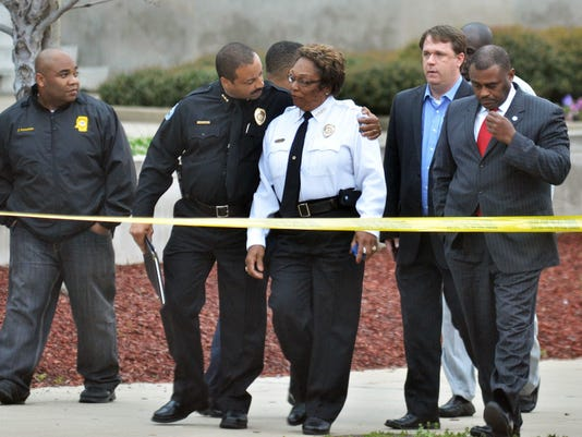 Officer, suspect dead at police HQ in Mississippi