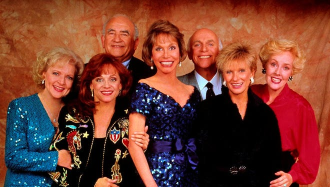 Betty White, left, Valerie Harper, Ed Asner, Mary Tyler Moore, Gavin MacLeod, Cloris Leachman and Georgia Engel, the original cast of the 'Mary Tyler Moore Show.' White reunites with her former co-stars for an upcoming episode of  'Hot in Cleveland.'
