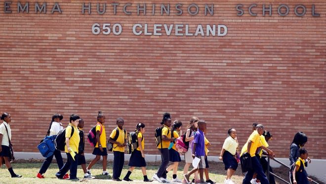 Students at Emma Hutchinson School in Atlanta leave after the day's classes.  Hutchinson has been identified as one of forty four schools involved in a test cheating scandal.