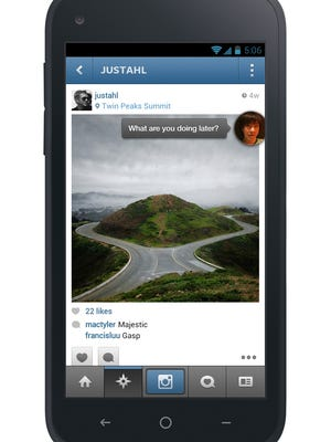 The HTC First, running Chat Heads, one of the features of Facebook Home.