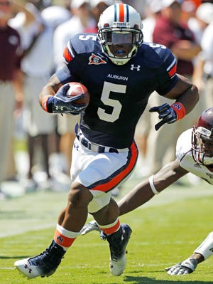 Former running back Michael Dyer is among at least a dozen members of Auburn's 2010 team to fail a test for synthetic marijuana, according to an ESPN report.