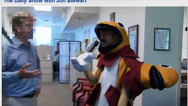 The Daily Show's Aasif Mandvi dresses up as a two-headed fish to interview EPA officials about selenium pollution in a screen-grab of a June 14, 2012 report.