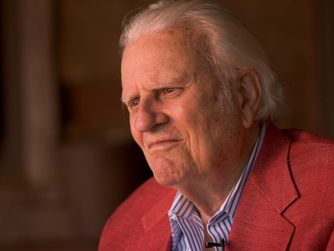 Billy Graham sits on the porch of his cabin May 12, 2005, in Montreat, N.C.