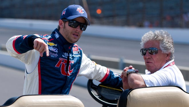 Marco Andretti, left, chats with grandfather Mario Andretti during practice for the 2012 Indianapolis 500.
