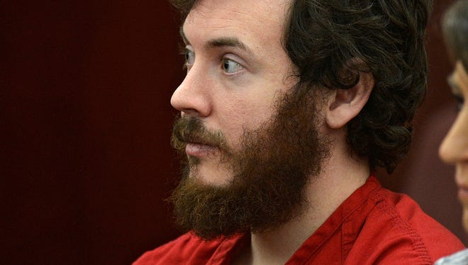 In this March 12 file photo, James Holmes appears in district court in Centennial, Colo. for his arraignment.