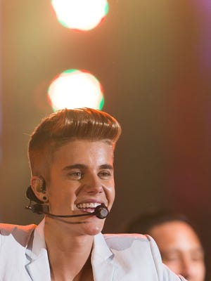 """Justin Bieber performs on stage during the """"I Believe Tour """" in Berlin on March 31."""