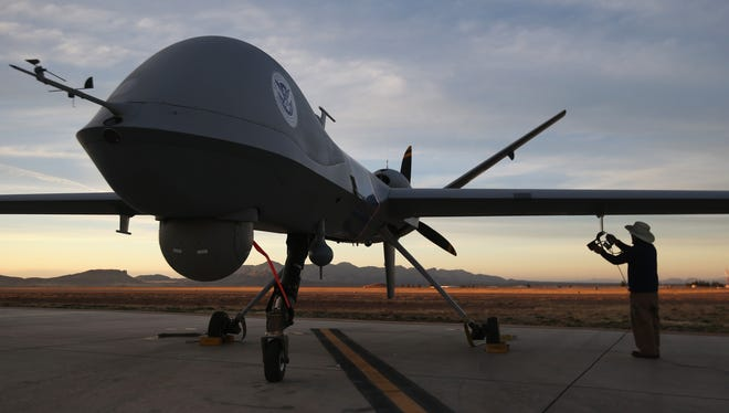Maintenence personnel at Fort Huachuca in Sierra Vista, Ariz., checked a Predator drone operated by  the U.S. Customs and Border Protection agency before its surveillance flight near the Mexican border March 7.