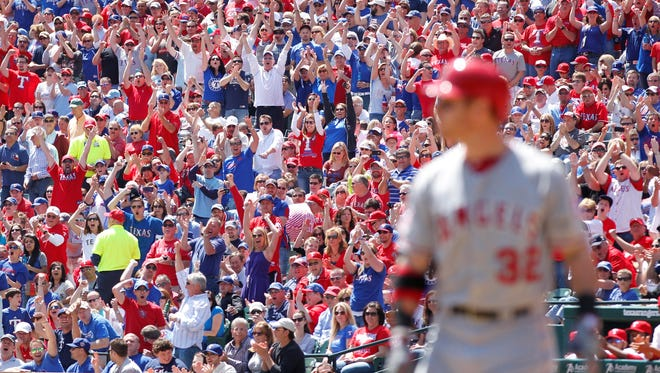 Rangers fans cheer after Angels right fielder Josh Hamilton strikes out in his first at bat.