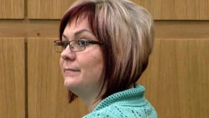 The woman known as Juror Five appeared at the Jodi Arias murder trial Thursday, two days after being tossed from the jury.