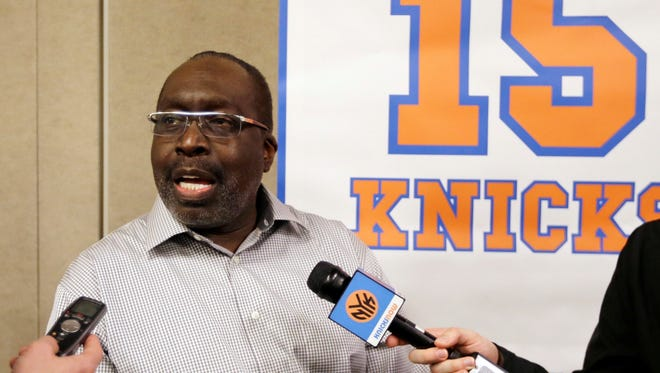 New York Knicks Hall-of-Famer Earl Monroe responds to questions during an interview before being honored at the halftime celebration.