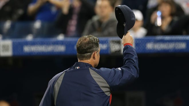 Boston Red Sox manager John Farrell reacts to fans before their game against the Toronto Blue Jays at Rogers Centre.