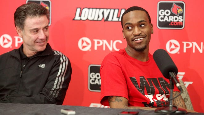 Louisville Cardinals player Kevin Ware (right) and head coach Rick Pitino attend a press conference at the KFC Yum! Center practice facility on Wednesday.
