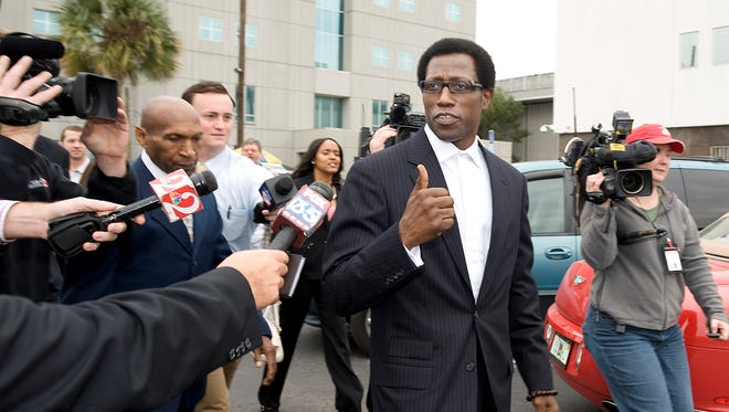 Wesley Snipes gives a thumbs up to the media as he leaves U.S. Federal Court in Ocala, Fla., on   Jan. 31, 2008.