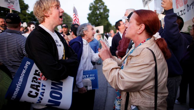 Supporters on both sides of the health care reform issue argue in Skokie, Ill., in 2009.