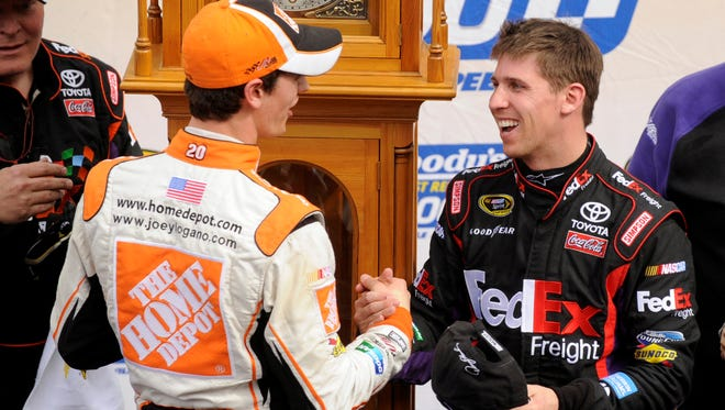 In happier days between them, Denny Hamlin, right, was congratulated by Joey Logano after winning March 29, 2010 at Martinsville Speedway. The former Joe Gibbs Racing teammates currently aren't talking after feuding all season.