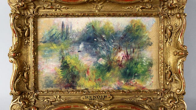 This apparently original painting by French impressionist Pierre-Auguste Renoir was acquired by a woman from Virginia who stopped at a flea market in West Virginia and paid $7 for a box of trinkets that included the painting.