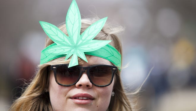 Casey Sayen, 21, of Bay City shows off her cannabis hat during the 42nd Annual Hash Bash at the University of Michigan on Saturday, Apr. 6, 2013 in Ann Arbor, Mich.