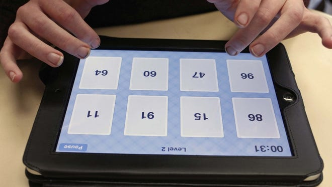 Students in Sioux Falls, S.D., will be assigned iPads or Chromebooks for school use.