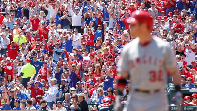 Rangers fans cheer after Josh Hamilton struck out in his first at bat on Friday.