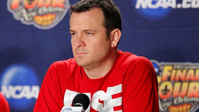 Louisville women's coach Jeff Walz, addressing the media during preparations for the NCAA Womens Final Four on Saturday, is much more comfortable in a t-shirt than a suit.