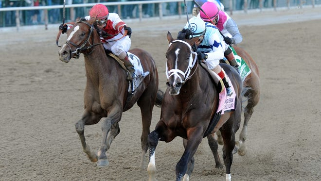 Verrazano, front right, with John Velazquez aboard, captures The Grade I Wood Memorial  at Aqueduct in New York on Saturday.