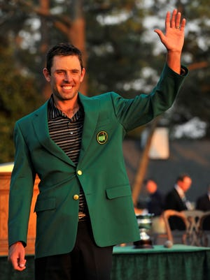 Charl Schwartzel of South Africa acknowledges the cheers following his victory in the 2011 Masters.