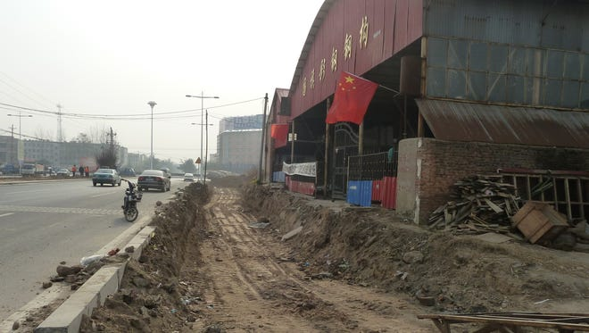 Last year, officials clearing land for a road enlargement dug this large trench, cutting off roadside access to the steel business belonging to Shi Guoqi in central China's Henan province.