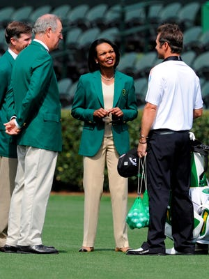 Former Secretary of State Condoleezza Rice talks with 2008 Masters champion Trevor Immelman and a couple of her fellow members.