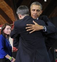 President Obama hugs Ian Hockley as his wife Nicole Hockley watches after they introduced Obama as he arrived to speak on gun control on April 8, 2013 at the University of Hartford, in Hartford, Connecticut. The Hockley's son was killed in the Newtown school shooting.
