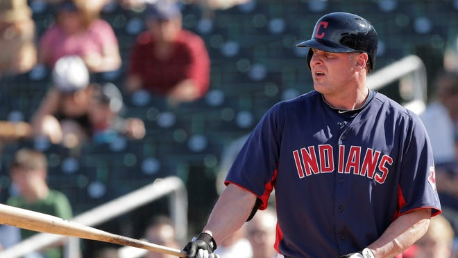 Now 42 years old, Jason Giambi, right, assumes a role with the Indians that is more coach than impact player.