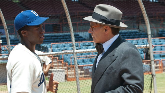 "Chadwick Boseman, left, and Harrison Ford appear in a scene from the motion picture ""42."""