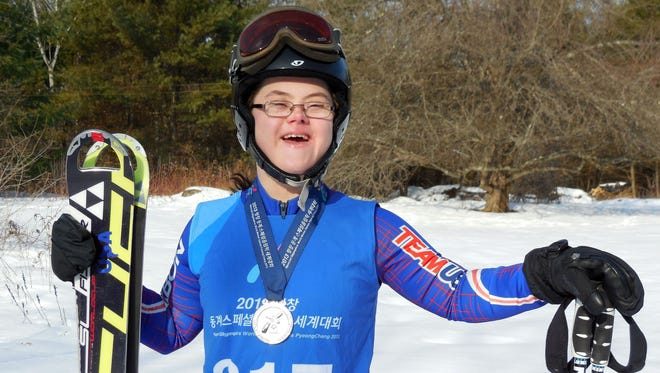 Melissa Reilly poses with the silver medal that she won after finishing in second place at the 2013 Special Olympics in February in Pyeongchang, South Korea.