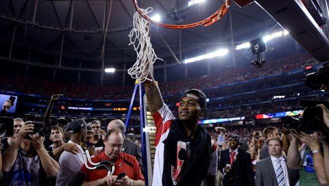 Louisville Cardinals guard Kevin Ware reacts after cutting down the net after the championship game in the 2013 NCAA mens Final Four against the Michigan Wolverines.