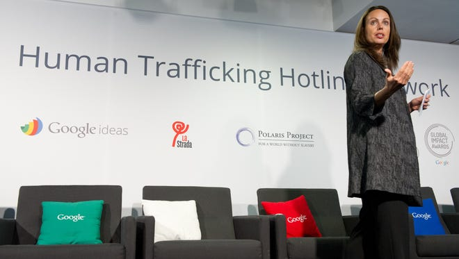 Jacquelline Fuller, director of Google Giving, makes an announcement about technology's role in aiding anti-trafficking efforts at Google's Washington, D.C., headquarters on Tuesday.