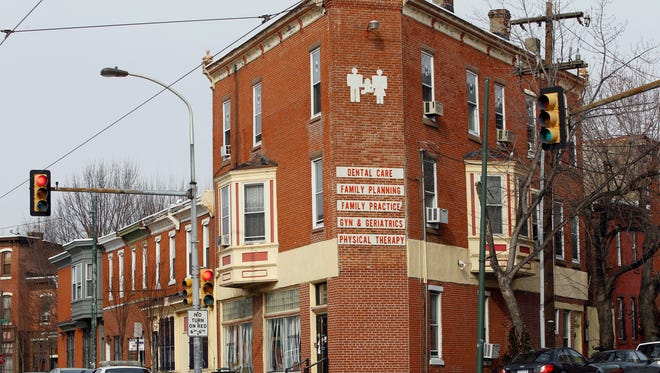 A police care is posted outside the the Women's Medical Society on Jan. 20, 2011, in Philadelphia after abortion doctor Kermit Gosnell was charged the day before with eight counts of murder in the deaths of a patient and seven newborns.